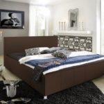 SAM® Design Polsterbett Katja, weiß, pflegeleichtes Bett aus Kunstleder, abgestepptes Kopfteil, Chrom-Füße, gepolstertes Designer-Bett, 100 x 200 cm